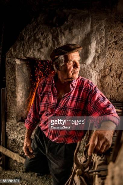 Portrait of Senior Blacksmith Man
