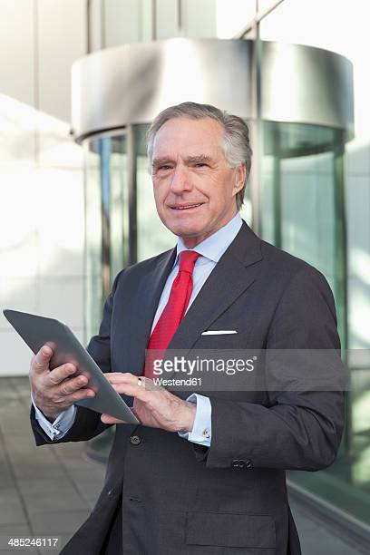 Portrait of senior business man with tablet computer