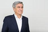 Portrait of Caucasian senior businessman horizontal studio shot