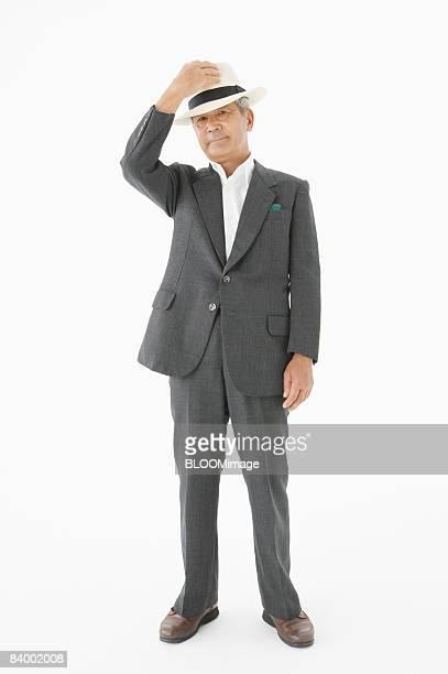 Portrait of senior businessman, studio shot
