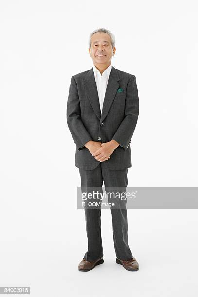 Portrait of senior businessman, studio shot