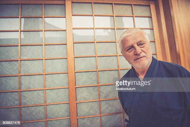 Portrait of Senior Caucasian Man in Buddhist Temple, Kyoto, Japan