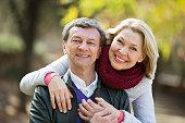 Portrait of happy loving senior couple enjoying spring day  in park