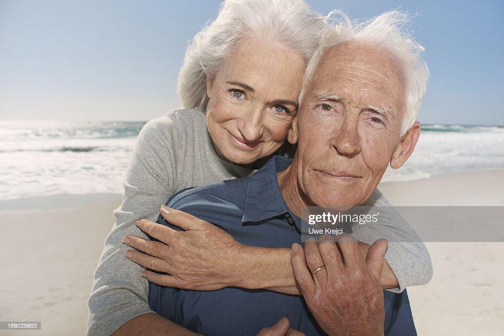 Portrait of senior couple on beach : Stock Photo