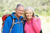 Portrait Of Senior Couple On Hike Smiling