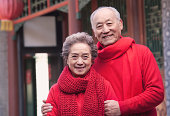 Portrait of Senior Couple outside by a traditional Chinese building