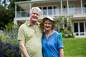 Portrait of senior couple standing in lawn