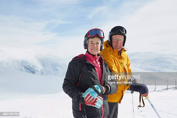 Portrait of senior couple skiing, Hermavan, Sweden