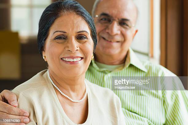 Portrait of senior couple smiling indoors