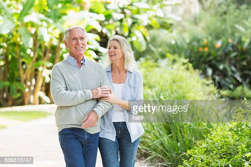 Portrait of senior couple walking in the park