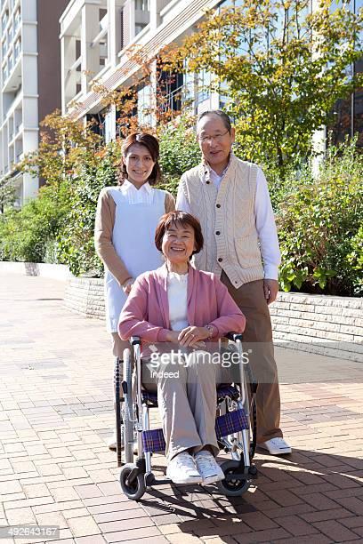 Portrait of senior couple with home caregiver