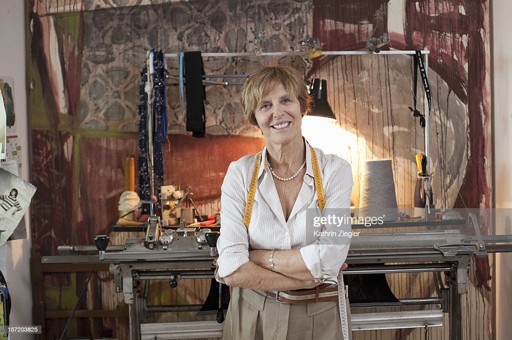 portrait of senior fashion designer in her studio : Stock Photo