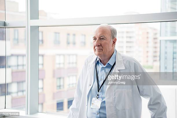 Portrait of senior male consultant in hospital with serious expression