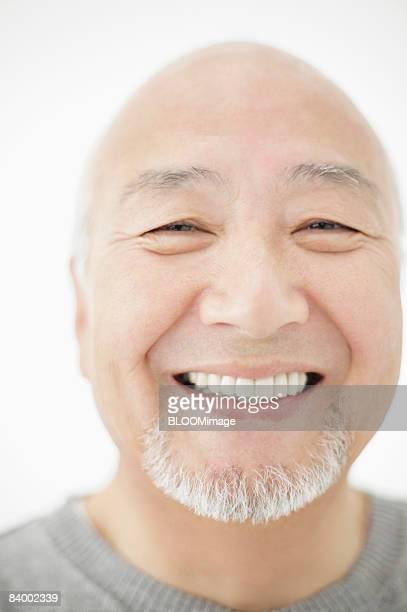 Portrait of senior man, close-up, studio shot
