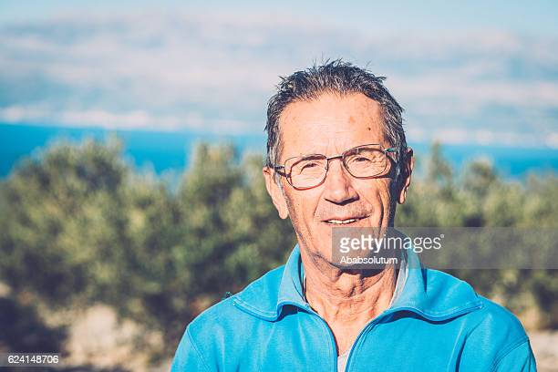 Portrait of Senior Man Harvesting Olives in Brac, Croatia, Europe