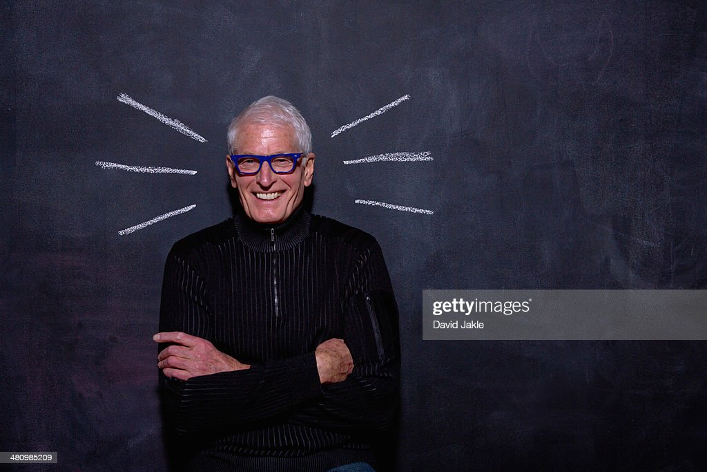 Portrait of senior man in front of chalked lines on blackboard : Stock Photo