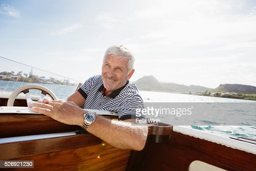 Portrait of senior man in motorboat : ストックフォト