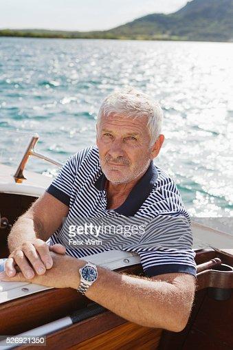 Portrait of senior man in motorboat : Stockfoto