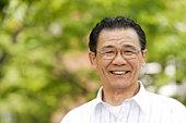 Portrait of senior man smiling, differential focus