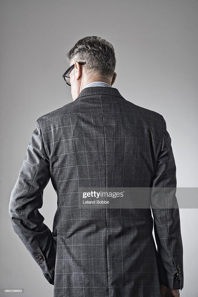 Portrait of senior man, wearing suit, rear view
