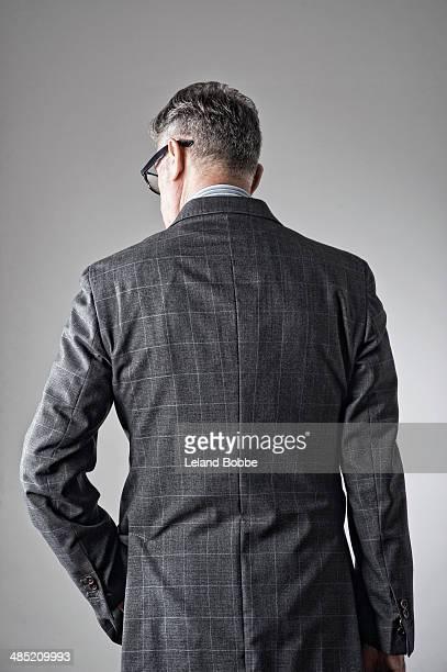 Portrait of senior man, wearing suit, rear view