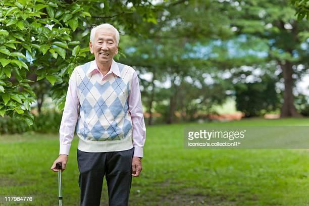 Portrait of senior man with cane, Tokyo Prefecture, Honshu, Japan
