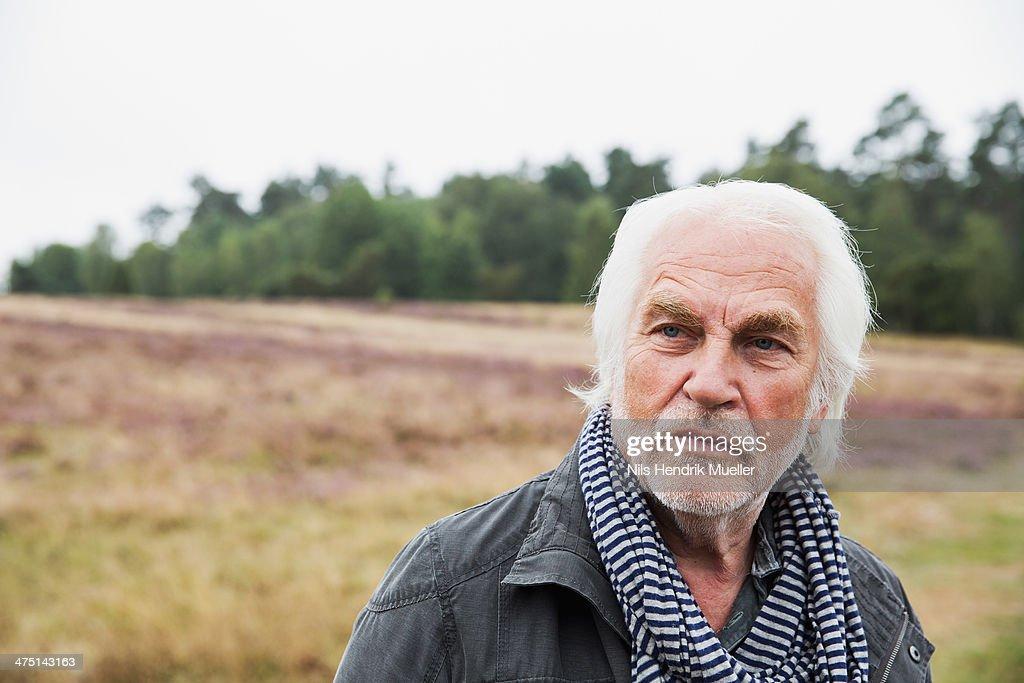 Portrait of senior man with grey hair