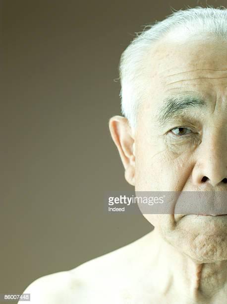 Portrait of senior men, staring
