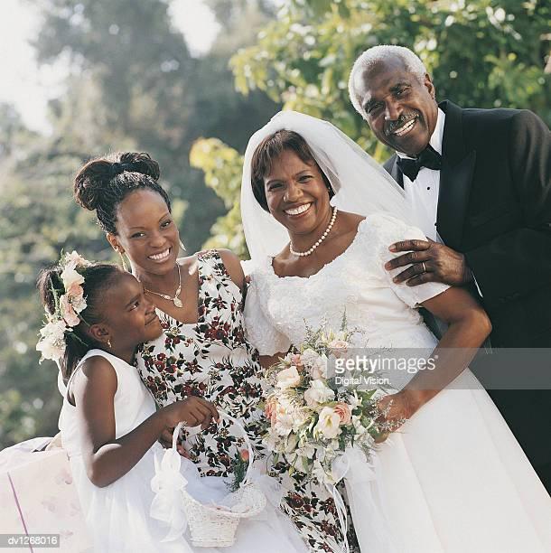 Portrait of Senior Newlyweds With Family