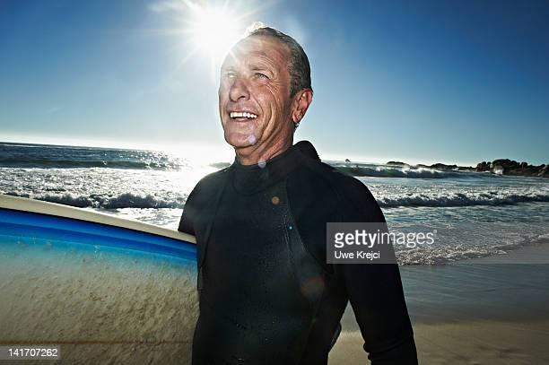 Portrait of senior surfer on beach
