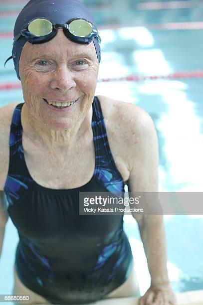 Portrait of senior swimmer  in pool