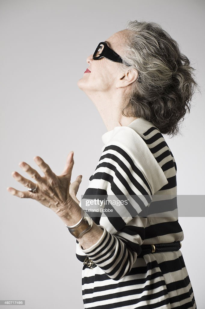 Portrait of senior woman, arms open, side view : Stock Photo