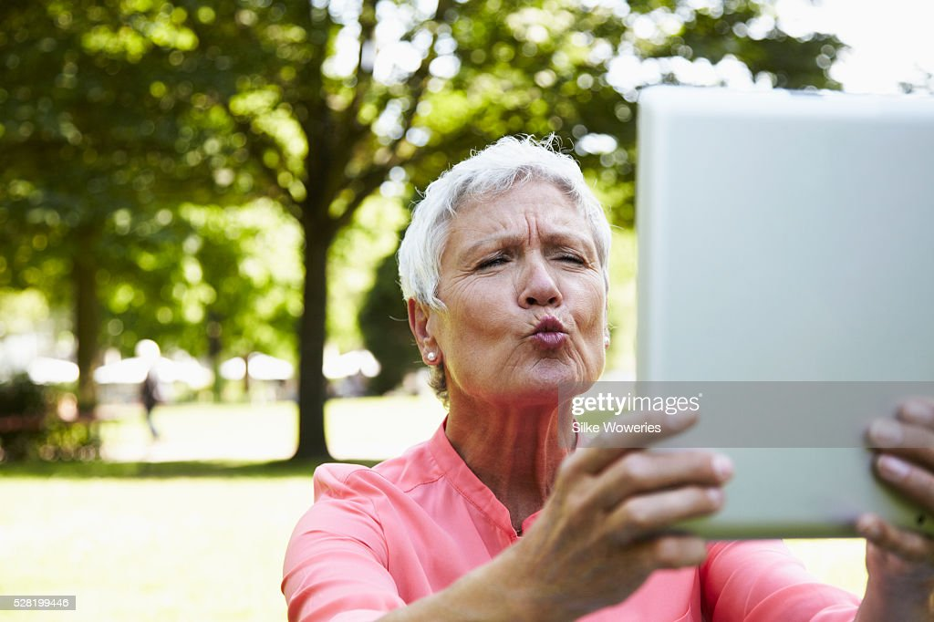 Young Woman Mobile Blowing Kiss Stock Photos &- Young Woman Mobile ...