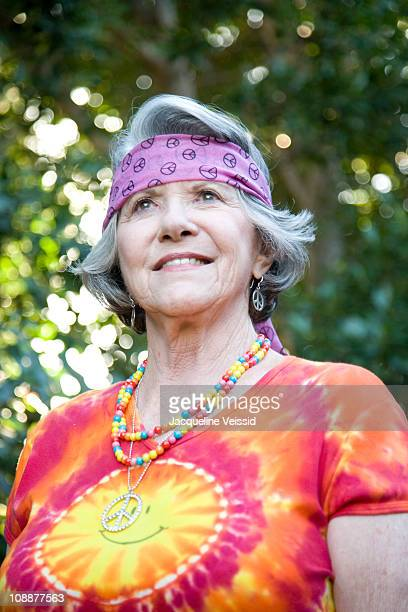 Portrait of senior woman dressed as a hippie