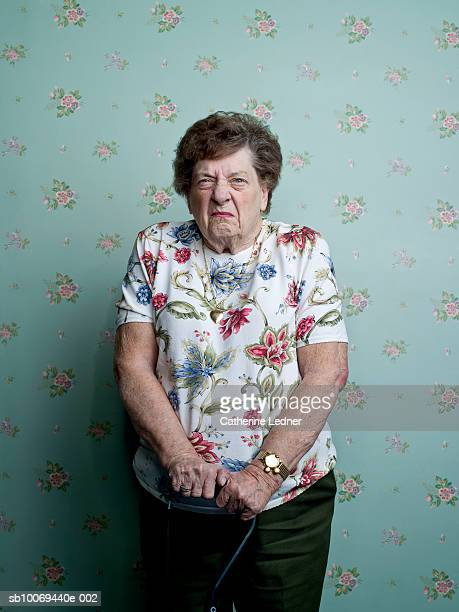 Portrait of senior woman frowning