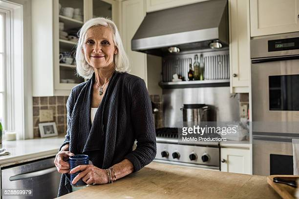 portrait of senior woman in kitchen