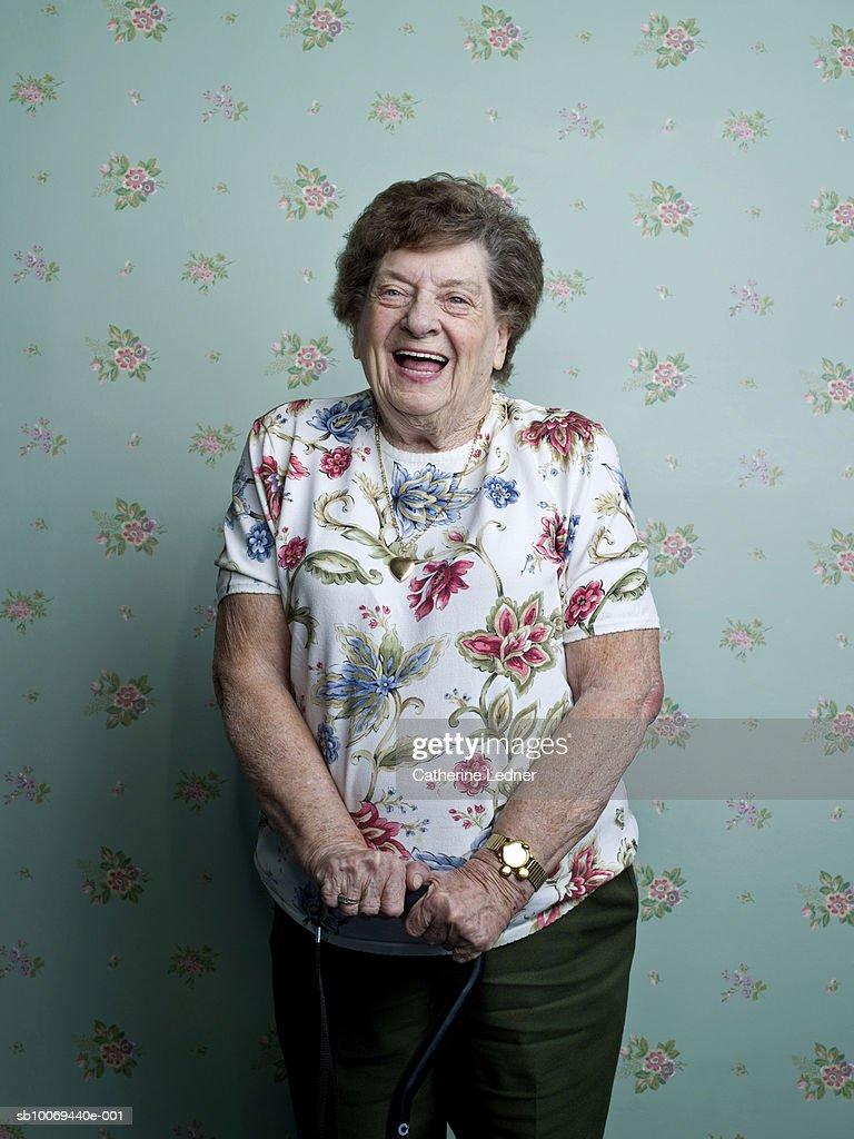 Portrait of senior woman laughing : Stock Photo