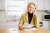 Portrait of senior woman on cordless phone