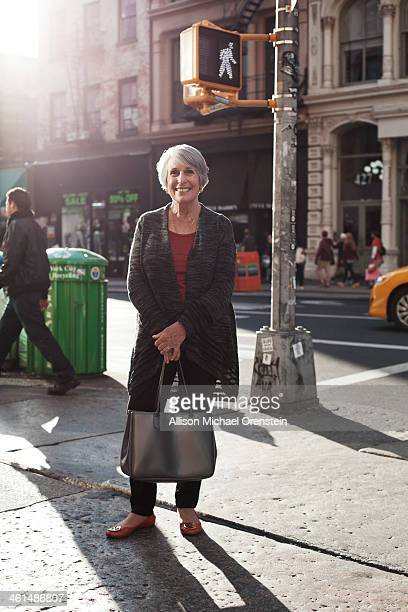 portrait of senior woman on street corner in city