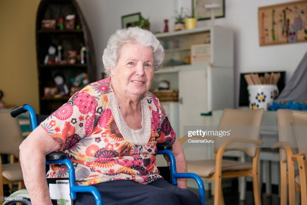 Portrait Of Senior Woman Sitting On The Wheelchair : Stock-Foto