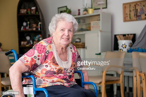 Portrait Of Senior Woman Sitting On The Wheelchair : ストックフォト