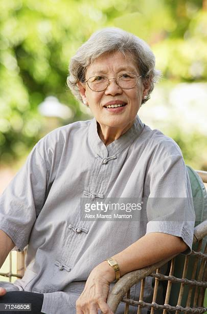 Portrait of senior woman, smiling at camera
