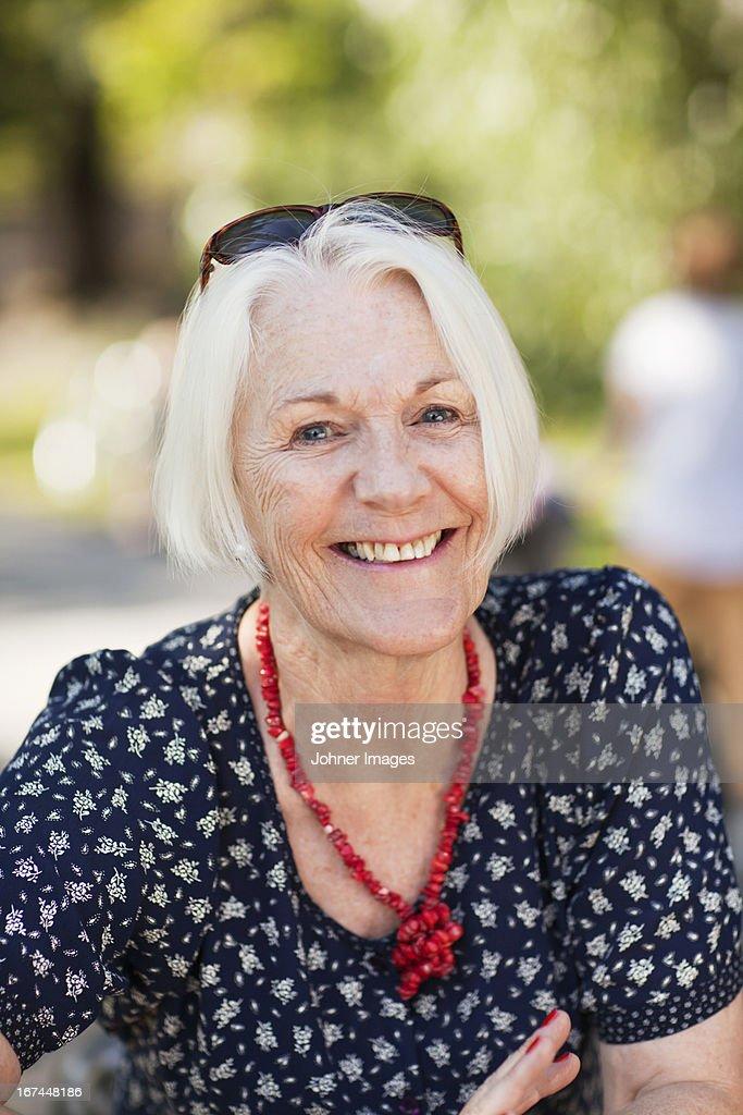 Portrait of senior woman smiling : Stock Photo