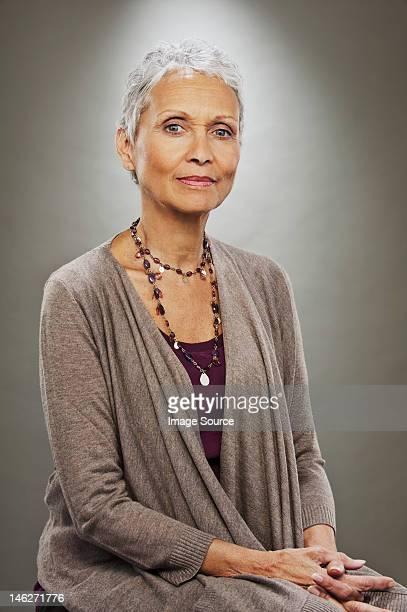 Portrait of senior woman smiling, studio shot
