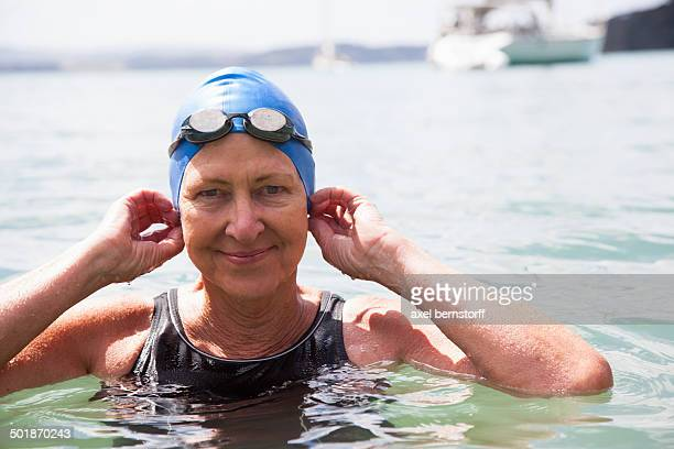 Portrait of senior woman swimmer in sea