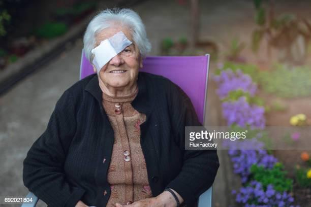 Portrait of senior woman with bandage on eye