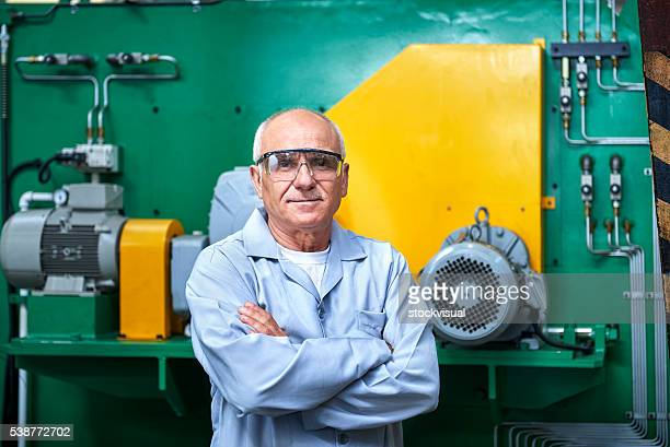 Portrait Of Senior Worker In Factory