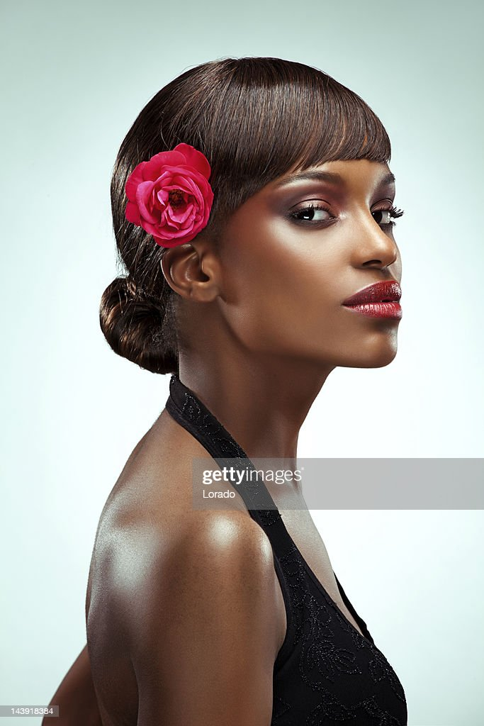 portrait of sensual black model with flower in hair : Stock Photo