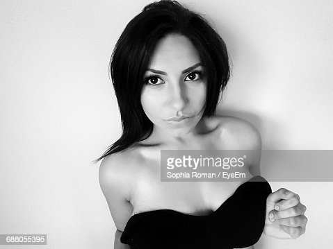 Portrait Of Sensuous Young Woman Against White Background
