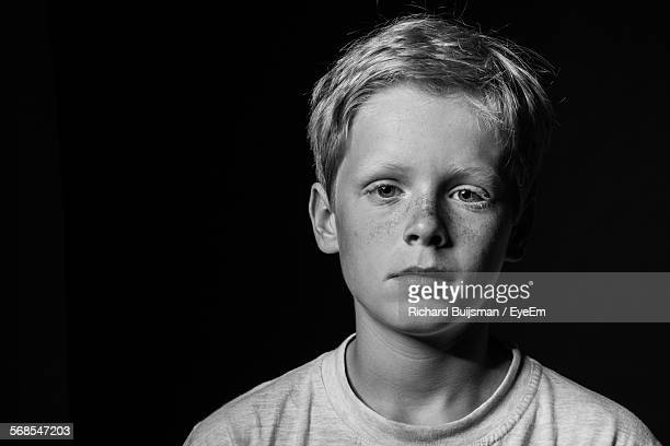Portrait Of Serious Boy At Home